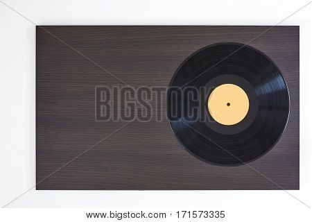 Vinyl record on wooden brown and white board