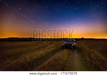 Milky Way Over Stubble Field, Car And Rural Sandy Road