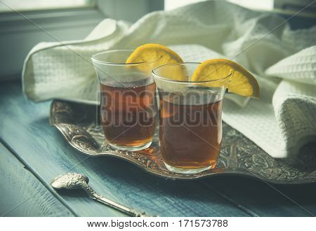 Traditional Turkish tea with lemon on a tray. LOMO effect