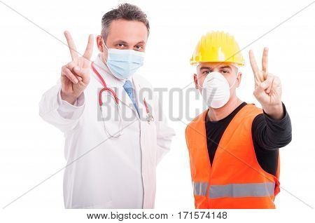 Doctor And Constructor Showing Peace Gesture