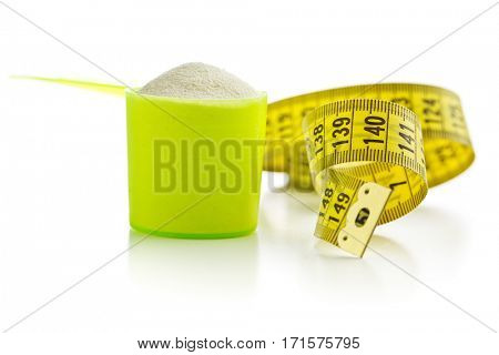 Whey protein powder and measuring tape.