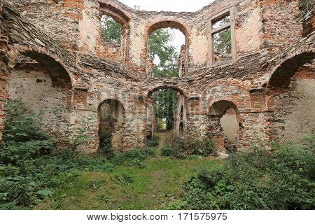Broken brick walls inside the ruined summer villa