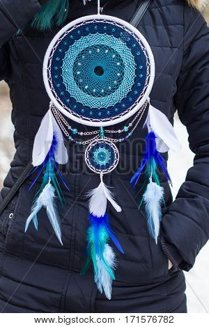 Blue and white Dreamcatcher made of feathers leather beads and ropes hanging
