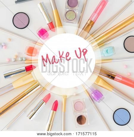 Colorful make up flat lay scene on white background with copy space