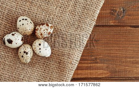 Quail eggs lying on the sacking. The concept of healthy eating and vegetarianism.