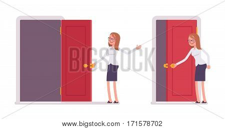 Young smiling female clerk in formal wear opening red door, welcoming new clients, showing opportunity, inviting to enter the office, and join the company, full length, isolated, white background