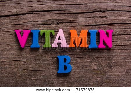 vitamin B word made from colored wooden letters on an old table. Concept