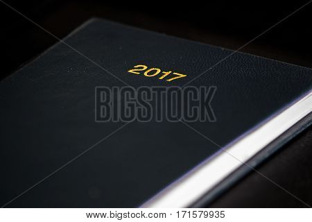 The 2017 title on the front cover of a diary.