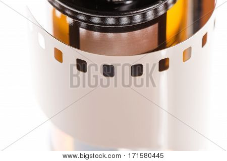 Close up shot of 35mm photographic film and its canister