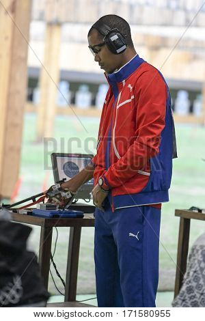 Rio Brazil - august 10 2016: GRAU POTRILLE Jorge (CUB) during shooting 50m Pistol Men Shooting at Olympic Games 2016 in Olympic Shooting Centre Deodoro