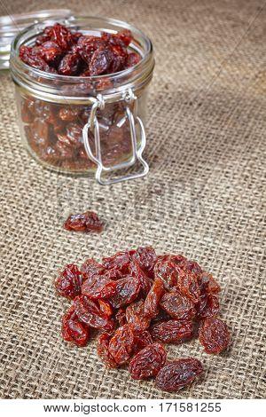 Organic Raisins On A Linen Background.