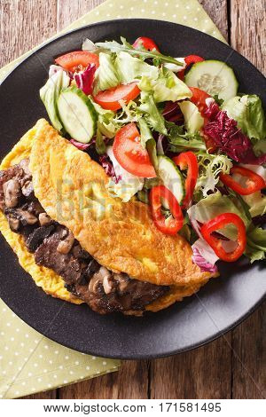 Austrian Cuisine: Imperial Cutlet With Mushrooms, Scrambled Eggs And Fresh Salad Closeup. Vertical T