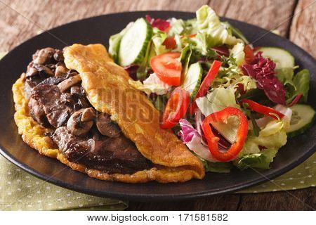 Austrian Cuisine: Imperial Cutlet With Mushrooms, Scrambled Eggs And Fresh Salad Closeup. Horizontal