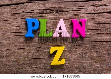 plan Z word made from colored wooden letters on an old table. Concept