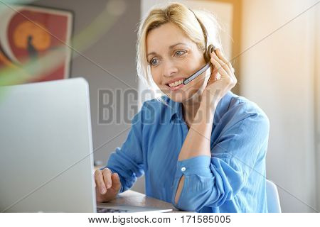Sales representative woman working from home-office