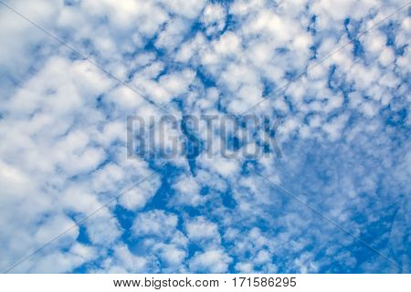 Fancy shapes of flying clouds in blue sky. Heavenly background in a highly patterned top. Free space atmospheric flight and freedom.