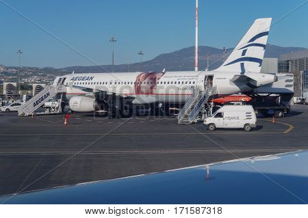 Thessaloniki, Greece - September 23 2016: Aegean airlines aircraft at airport. Aegean Airlines Airbus A320 parked on the runway of Thessaloniki International Airport Macedonia. Shot inside aircraft.