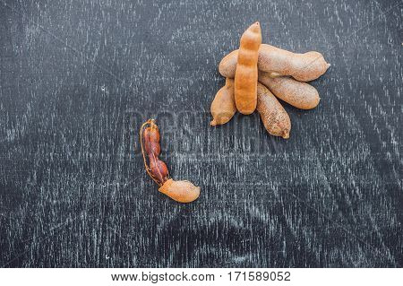 Sweet Ripe Tamarind Pods On Old Wood Background