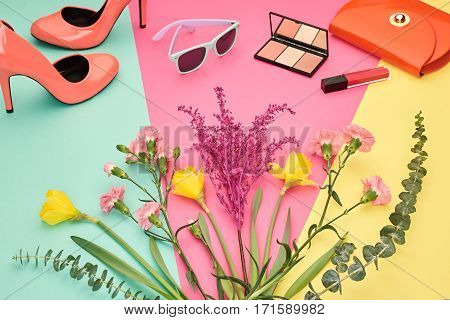 Fashion Design Spring Accessories Set, Essentials, Cosmetic.Trendy sunglasses, fashion Handbag clutch, Bouquet of multicolored flowers. Glamor shoes heels, Summer lady Essentials. Creative Concept. Art.