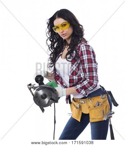 Project Satisfaction. Beautiful sexy brunette woman in goggles with a circular saw, isolated on white background