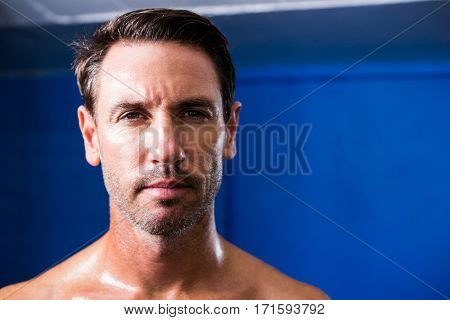 Close-up portrait of athlete in gym