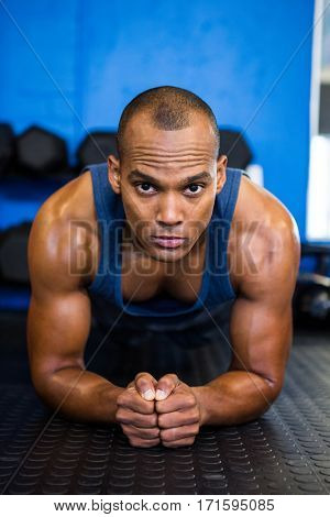 Portrait of serious sporty athlete exercising in gym