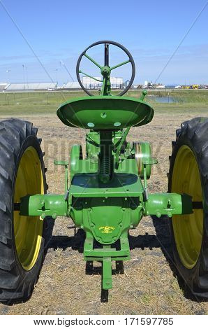 WEST FARGO, NORTH DAKOTA, September 13, 2106: The restored old John Deere tractor is product of John Deere Co, an American corporation that manufactures agricultural, construction, forestry machinery, diesel engines, and drivetrains.