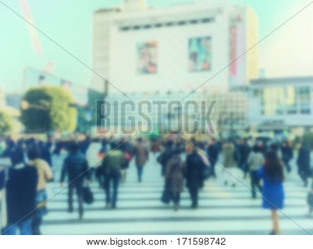 Vintage style abstract blur . People walking in Shibuya Crossing in Tokyo Japan.