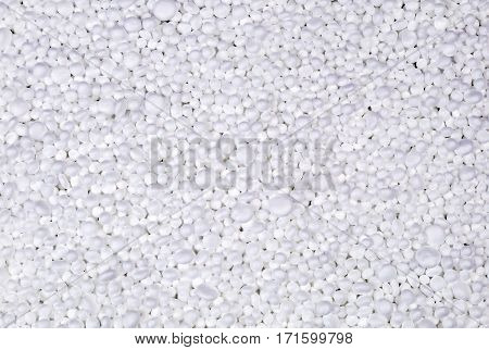 Filler of small white pieces of styrofoam for packaging. For background or  texture.