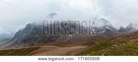 Kazakhstan mountains. Cloudy mountains of Medeu in Kazakhstan Shymbulak.