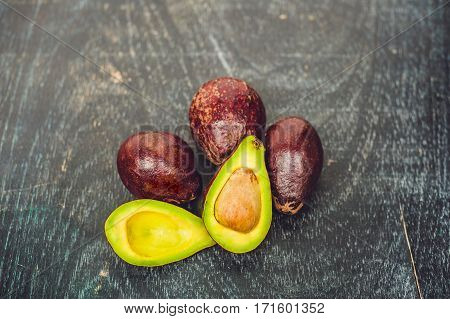 Fresh Organic Avocado On Dark Old Wooden Table, Side View