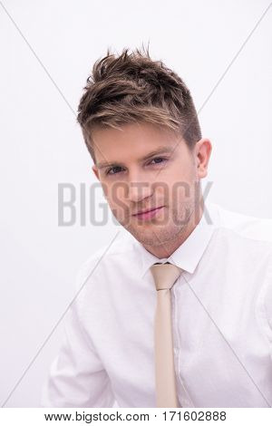 Portrait of a young handsome man in a representative strict clothing smiling isolated on white background
