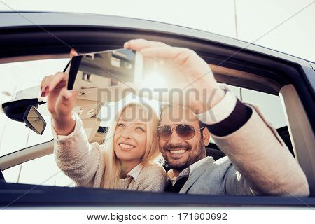 Happy to travel together.Joyful young couple smiling while riding in their car.