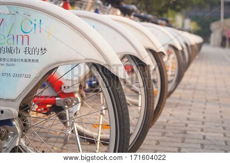 Shenzhen, China: February 11th, in 2017, bicycle rental facilities and a row of bicycles in the streets. In Shenzhen, china.