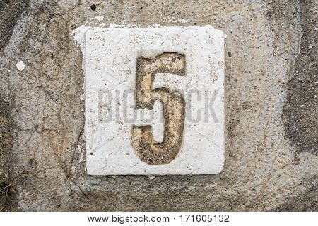 The Digits With Concrete On The Sidewalk 5
