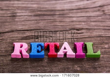 retail word made from colored wooden letters on an old table. Concept