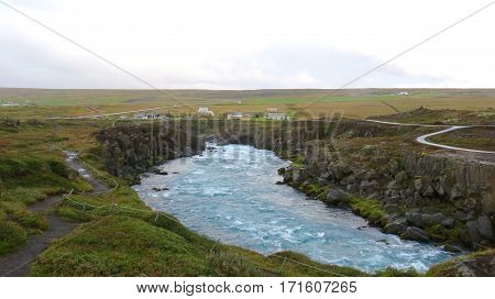 Rushing water through an Icelandic River Valley on a dreary day