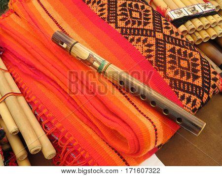 A handmade Peruvian wooden flute crafted by locals near Rach'i in Peru