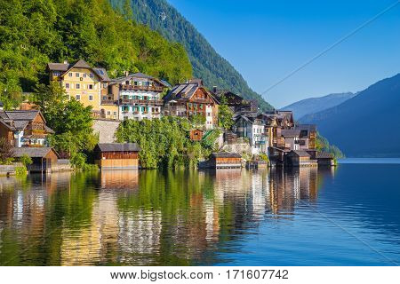 Scenic picture postcard view of traditional old wooden houses in famous Hallstatt mountain village at Hallstattersee lake in the Austrian Alps in summer region of Salzkammergut Austria