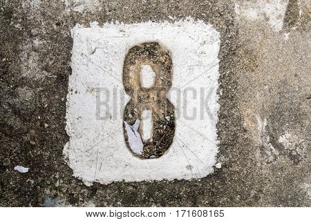 The Digits With Concrete On The Sidewalk 8