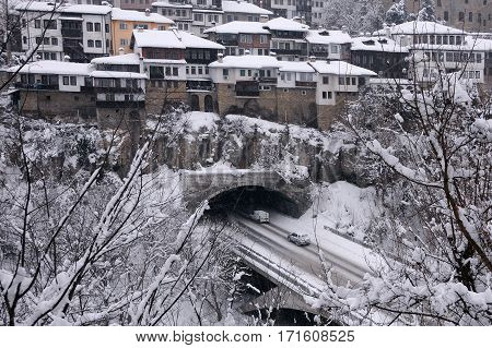 VELIKO TARNOVO BULGARIA - JANUARY 19 2017: Cars tunnel and houses on the hill in the winter