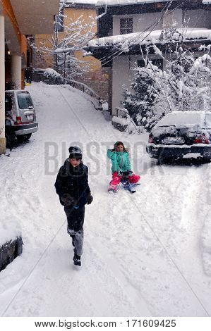 VELIKO TARNOVO BULGARIA - JANUARY 6 2017: Kids have fun in the Old town on the cold winter day