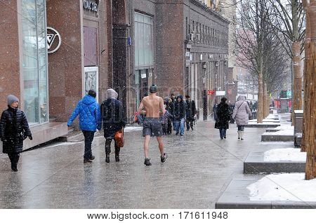TVERSKAYA STREET MOSCOW RUSSIA - FEBRUARY 12 2017: Unidentified bare-chested man walks down the main street of the city