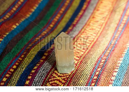 healing crystal stone on color fabric .