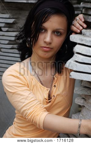 Full length shot of a casually dressed teen girl with a serious expression poster