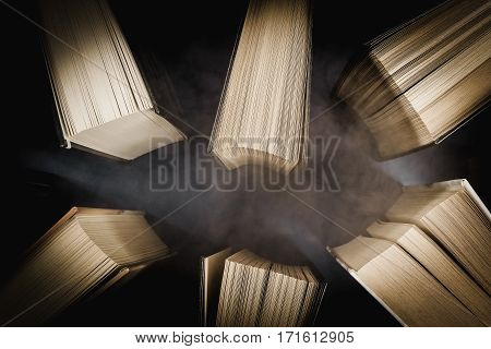 top view of old books in a fog on a gray table