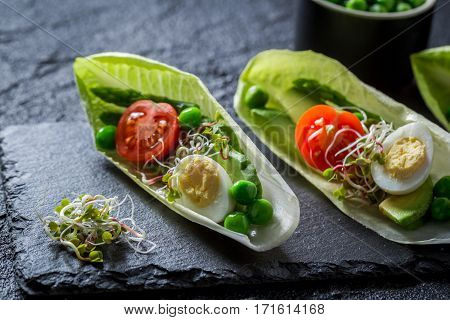 Healthy Salad In Chicory With Egg, Sprouts And Avocado