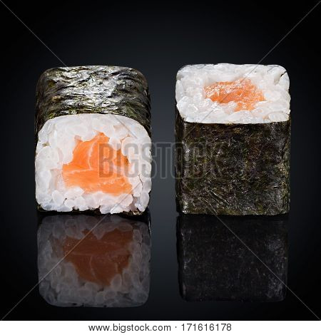 Roru Syake rolls with salmon on a black background