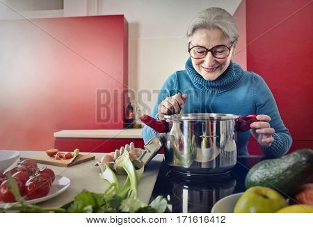 Lady in pretty kitchen cooking happily