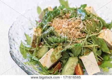 Tofu Salad with Arugula and onsen egg